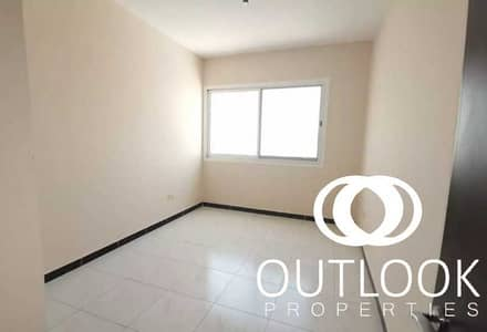 2 Bedroom Flat for Rent in Jumeirah Village Circle (JVC), Dubai - Unfurnished 2BR | Covered Parking | Near Park