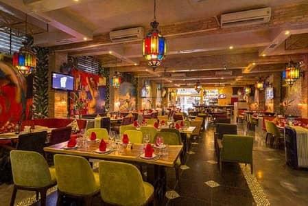 محل تجاري  للبيع في شارع الشيخ زايد، دبي - Hot Deal Restaurant and Cafe with Shisha License