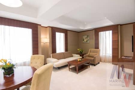 شقة فندقية 1 غرفة نوم للايجار في شارع الشيخ زايد، دبي - شقة فندقية في فندق كارلتون داون تاون شارع الشيخ زايد 1 غرف 110000 درهم - 5334731