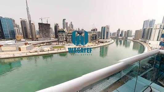 شقة 1 غرفة نوم للايجار في الخليج التجاري، دبي - شقة في برج ارت XV الخليج التجاري 1 غرف 54990 درهم - 5215740
