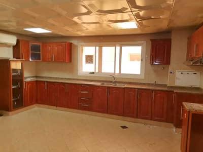 5 Bedroom Villa for Rent in Mohammed Bin Zayed City, Abu Dhabi - GROUND FLOOR KITCHEN