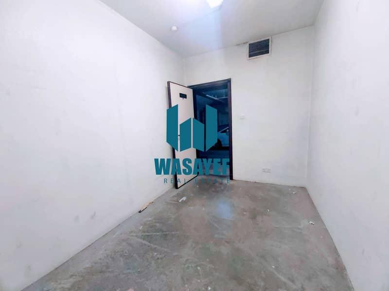 محل تجاري في بناية سبكتروم عود ميثاء بر دبي 18000 درهم - 5338657