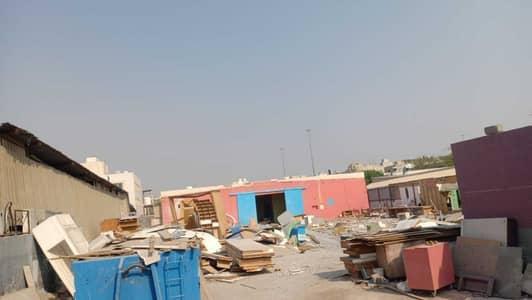 ارض صناعية  للايجار في المنطقة الصناعية، الشارقة - 20000 sqft plot with rooms & warehouse for rent !!