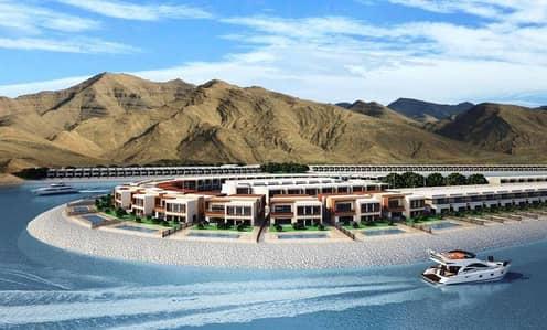 Villas in the heart of Al Dana Island on the beach of Al Aqah.