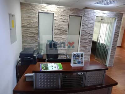 Office for Rent in Jumeirah Lake Towers (JLT), Dubai - A beautiful fitted office with partitions  on middle floor