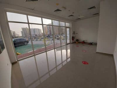 Shop for Rent in International City, Dubai - CBD - 25 - Vacant Shop 344 Sqft - One Covered Parking
