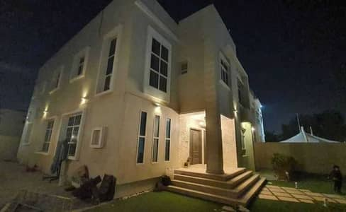 Two-storey villa for rent in Ajman, Al Hamidiya area, very clean, with air conditioners, behind the economic circle