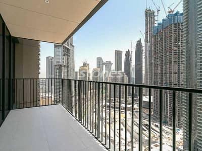 فلیٹ 3 غرف نوم للايجار في وسط مدينة دبي، دبي - Open Kitchen Layout | High Floor | Available Sept