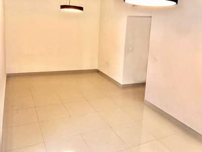 استوديو  للايجار في مدينة دبي الرياضية، دبي - Closed Kitchen | Community View