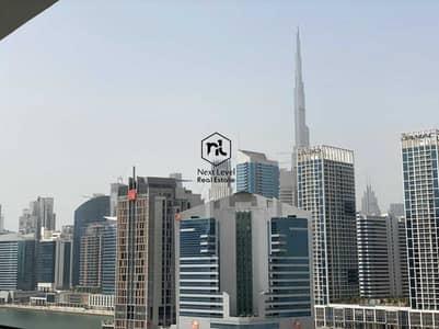 1 Bedroom Apartment for Rent in Business Bay, Dubai - KITCHEN APPLIANCES   OPEN KITCHEN   BURJ KHALIFA VIEW
