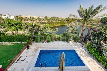 4 Bedroom Villa for Sale in Jumeirah Islands, Dubai - Beautiful Lake View + Vacant + Elevated + Garden Hall