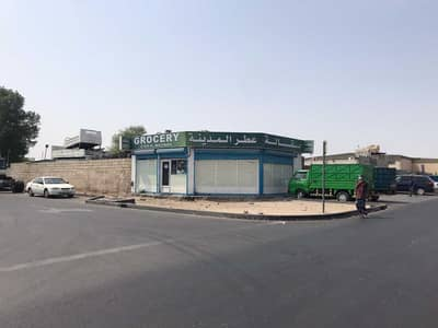 Industrial Land for Sale in Industrial Area, Sharjah - For sale a walled land in industrial area Ten -Sharjah - a strategic location