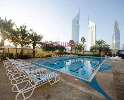 شقة فندقية 2 غرفة نوم للايجار في مركز دبي التجاري العالمي، دبي - Spacious 2BR |Furnished and Serviced| Near Metro