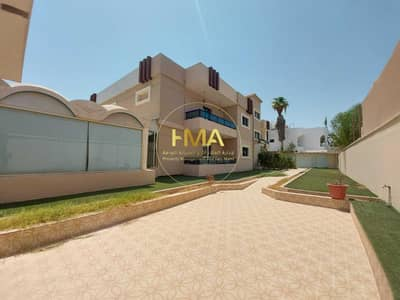 فيلا تجارية 10 غرف نوم للايجار في الكرامة، أبوظبي - فيلا تجارية علي شارع رئيسي فى الكرامة