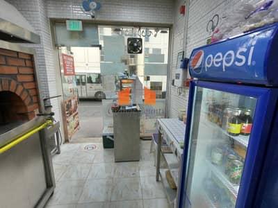 محل تجاري  للايجار في الكرامة، دبي - Running bakery for rent| Near ADCB metro station| Call now to grab this amazing oppurtunity. |