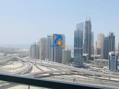 شقة 1 غرفة نوم للايجار في أبراج بحيرات الجميرا، دبي - HIGH FLOOR SEA VIEW UNFURNISHED 1 BHK IN JLT