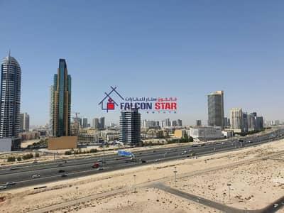 استوديو  للايجار في مدينة دبي الرياضية، دبي - LARGE STUDIO   MODULAR KITCHEN   BIG BALCONY WITH SIDE VIEW (2