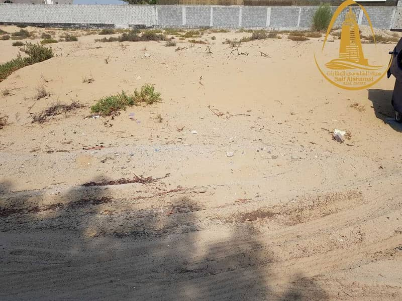 14 FOR SALE A RESIDENTIAL LAND IN AL GHARAYEN 1 AREA