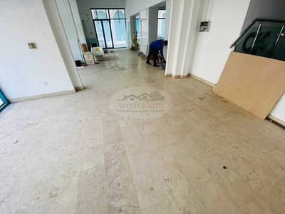 Showroom for Rent in Tourist Club Area (TCA), Abu Dhabi - Very Low Price! Spacious Showroom For Rent   GF + MF   Tourist Club   Well Maintained   Flexible Payments