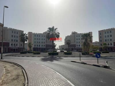 Shop for Sale in International City, Dubai - ROUNDABOUT SHOP FOR SALE IN ENGLAND CLUSTER 350