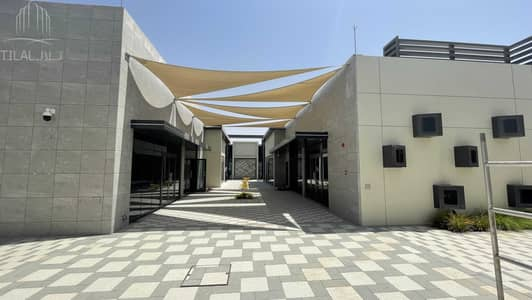 Shop for Rent in Tilal City, Sharjah - Shops for lease with affordable prices