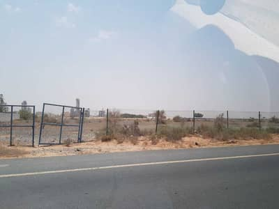 Plot for Sale in Al Yash, Sharjah - for sale residential plote Strategic location on main road. . .