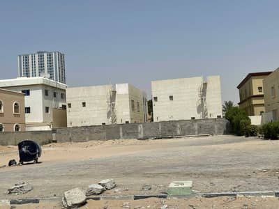 Plot for Sale in Al Rawda, Ajman - The land of Al-Rawda area on a commercial street, an area of 900 square meters