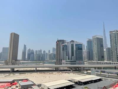 استوديو  للايجار في الخليج التجاري، دبي - Burj khalifa view  up to 4 chqs  Studio + balcony