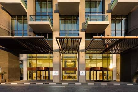 فلیٹ 1 غرفة نوم للايجار في الخليج التجاري، دبي - شقة في ميلينيوم اتريا الخليج التجاري 1 غرف 92000 درهم - 5395733