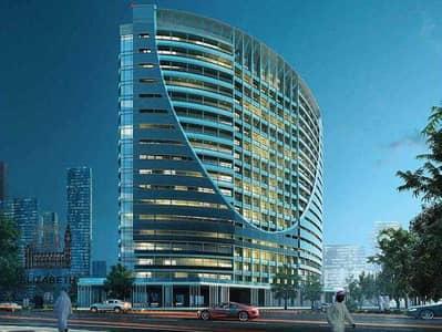 فلیٹ 2 غرفة نوم للبيع في مجمع دبي ريزيدنس، دبي - Furnished two-bedroom apartment in Tower V only 8000 dirhams per month for 4 years after handover
