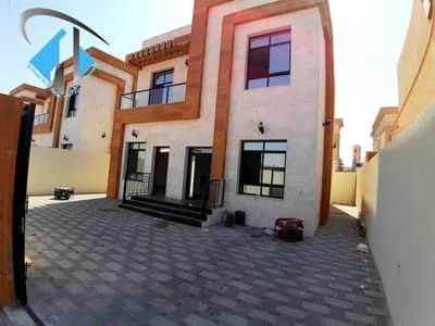 3 Bedroom Villa for Sale in Al Zahya, Ajman - For sale villa with a stone face, central air conditioning, high quality finishes, two floors, freehold for all nationalities, on Mohammed bin Zayed