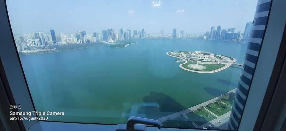 Apartment for sale on the Corniche of Lake Khaled in Al Majaz area