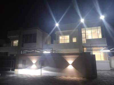 3 Bedroom Villa for Sale in Al Amerah, Ajman - Own the villa of life for you and your children without down payment with the best bank facilities, super deluxe finishing, facing stone, with electri