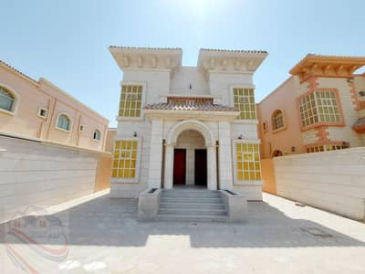 5 Bedroom Villa for Sale in Al Rawda, Ajman - For sale a villa in Ajman with a stone face, electricity and water with air conditioners, at a price of a snapshot, without down payment and on monthl
