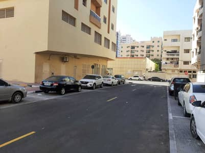 Plot for Sale in Al Nuaimiya, Ajman - 6400 SQ FT COMMERCIAL LAND 2 SIDES ROAD 2 SIDES SIKKA FANTASTIC DIMENSION NEAR AL HIKMAH SCHOOL AL NUAMIYAH 1