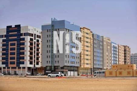 مبنی تجاري  للبيع في مصفح، أبوظبي - بناية تجارية في الشعبية على شارع رئيسي | 5 طوابق .