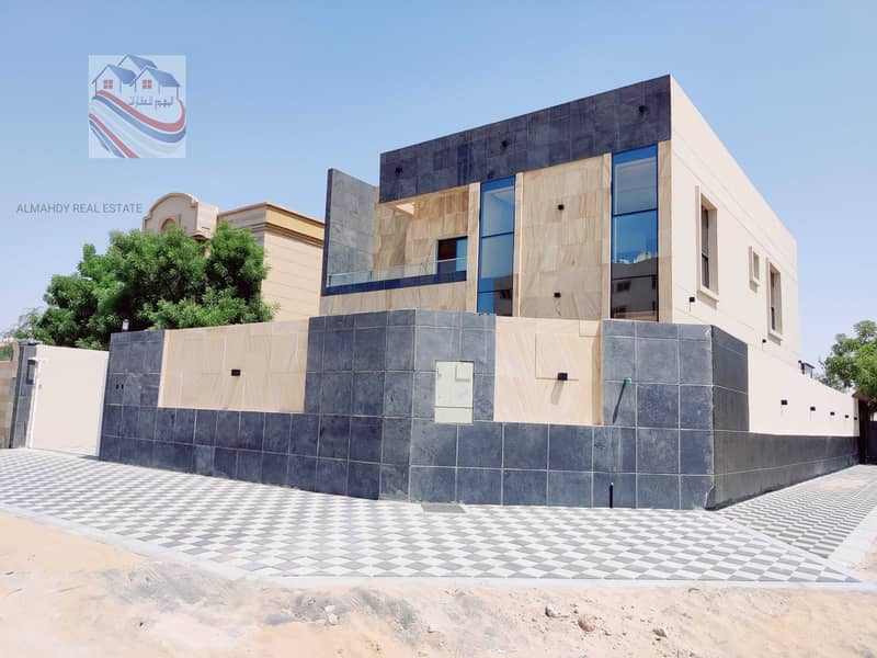 For sale villa on a street corner in the most prestigious areas of Ajman, freehold for all nationalities, close to all services in the Rawda area