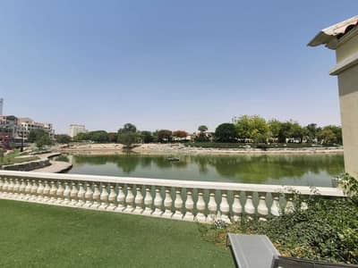 فلیٹ 3 غرف نوم للبيع في موتور سيتي، دبي - Exclusive / Stunning lake view / Ground Floor / Terrace