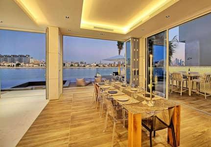 فیلا 5 غرف نوم للايجار في نخلة جميرا، دبي - Custom-Built Garden Home Overlooking the Beach