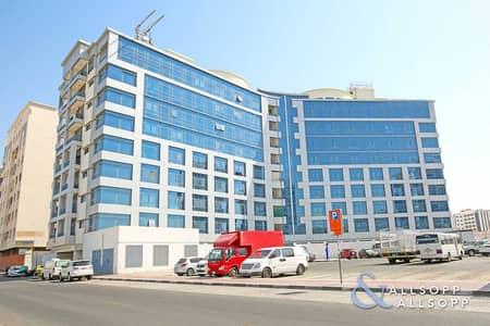 Building for Sale in Bur Dubai, Dubai - For Sale   ROI 6.46%   95% Tenant Occupied