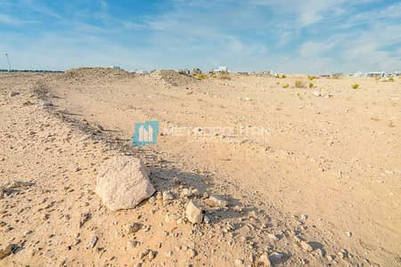 Plot for Sale in Al Gurm, Abu Dhabi - Huge Plot   Land Directly to Canal   Call Now