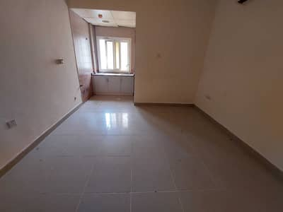 Studio for Rent in Muwailih Commercial, Sharjah - Spacious Studio with Separate Kitchen Prime Location Fire Station Road Muwaileh.