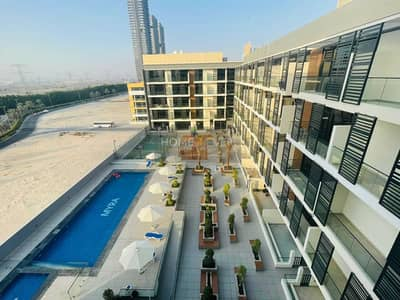 1 Bedroom Apartment for Rent in Jumeirah Village Circle (JVC), Dubai - Most Beautiful 1BR+Store|Huge Balcony with Pool View| All Kitchen Appliances