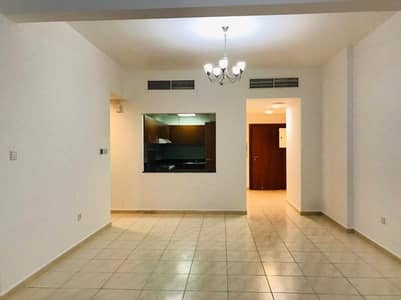 2 Bedroom Apartment for Sale in Dubai Residence Complex, Dubai - Low Price for 2bedroom with balcony   Rented  Apt.   Dubai land view