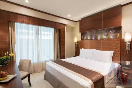 شقة فندقية 1 غرفة نوم للايجار في شارع الشيخ زايد، دبي - شقة فندقية في فندق كارلتون داون تاون شارع الشيخ زايد 1 غرف 100000 درهم - 5449340