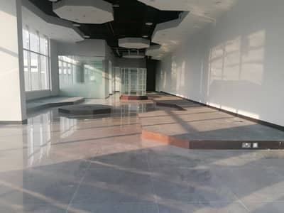 Shop for Rent in Al Garhoud, Dubai - Spacious Shop with Pantry and Washroom