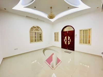 5 Bedroom Villa for Sale in Al Rawda, Ajman - Urgent sale villa in Ajman connected to electricity and water with air conditioners on a street underway, very excellent finishing, without down payme