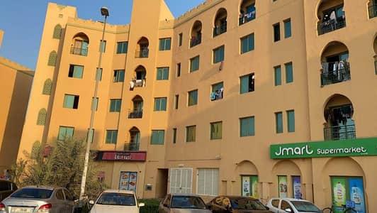 فلیٹ 1 غرفة نوم للايجار في المدينة العالمية، دبي - شقة في الحي المغربي المدينة العالمية 1 غرف 23000 درهم - 5469727