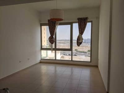 شقة 1 غرفة نوم للايجار في مدينة دبي للإنتاج، دبي - غرفة نوم واسعة + صالة للإيجار @ 29 ألف في Oakwood Residency IMPZ