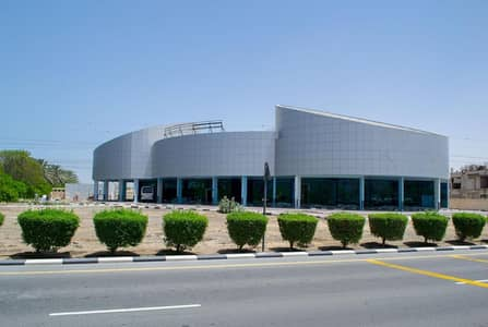 Building for Rent in Green Community, Dubai - Retail Center - Mall in a Prime Location